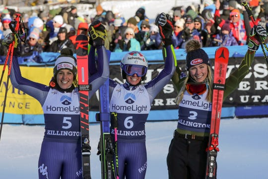 Italy's Marta Bassino, center, winner of an alpine ski, women's World Cup giant slalom, poses with second placed Italy's Federica Brignone, left, and third placed United States' Mikaela Shiffrin, in Killington, Vt., Saturday, Nov. 30, 2019.