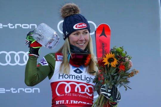 United States' Mikaela Shiffrin celebrates her third place in a alpine ski, women's World Cup giant slalom, in Killington, Vt., Saturday, Nov. 30, 2019.