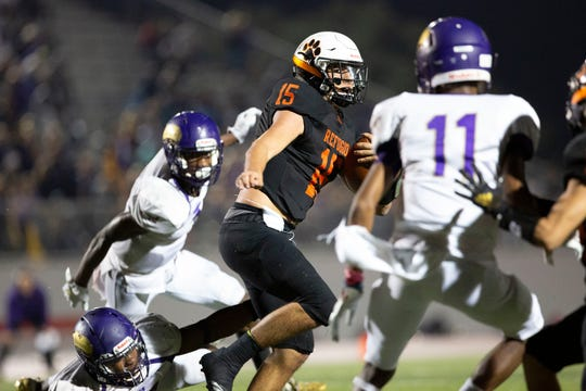 Refugio quarterback Austin Ochoa, slips past several Shiner defenders for positive yardage Friday during the Class 2A Division I regional round at Rutledge Stadium in Converse. The Bobcats beat the Comanches 45-43.