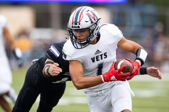 Veterans Memorial Cameron DeLaPena runs the ball during the first quarter of the 5a Division I regional semifinal against Miller at Buccaneer Stadium on Nov. 29, 2019.