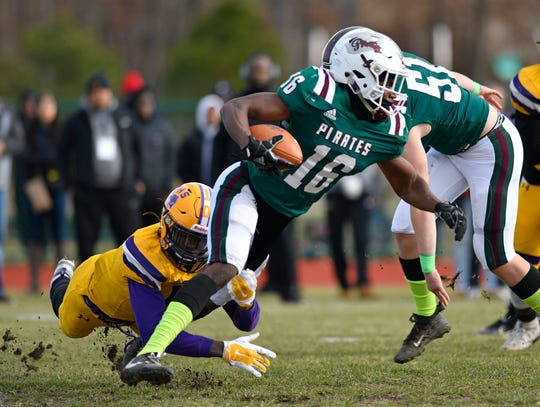 Cedar Creek's Malachi Melton runs for a gain against Camden on Saturday. The Pirates topped the visiting Panthers 31-23 to win the Central Jersey Group II final on Nov. 30, 2019.