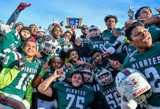 Cedar Creek celebrates after defeating Camden on Saturday. The Pirates topped the visiting Panthers 31-23 on Nov. 30, 2019.