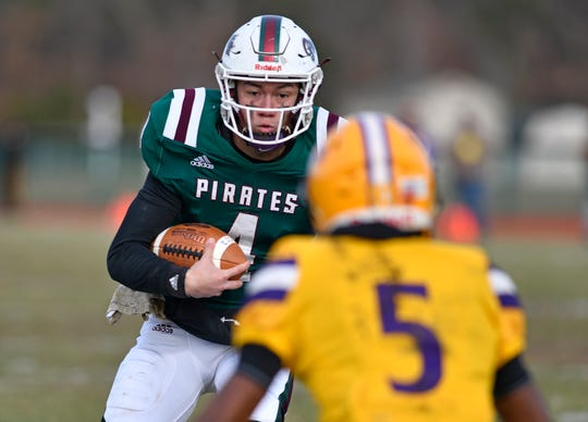 Cedar Creek quarterback Louie Barrios runs for a gain against Camden on Saturday. The Pirates topped the visiting Panthers 31-23 to win the Central Jersey Group II final on Nov. 30, 2019.