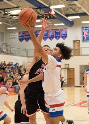 Zane Trace's Cam Evans takes the ball to the rim during a 70-51 win over Amanda-Clearcreek at the Zane Trace Tipoff Classic on Friday November 29, 2019.