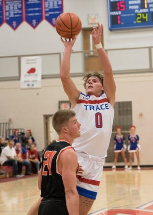 Zane Trace basketball's Colby Swain shoots the ball over a defender in a 70-51 win over Amanda-Clearcreek at the Zane Trace Tipoff Classic on Friday November 29, 2019.