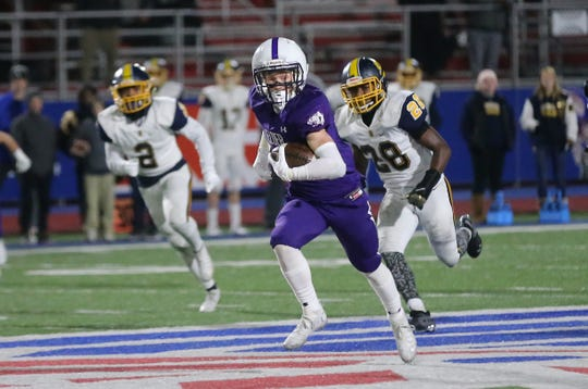 Elder wide receiver Evan Vollmer runs the ball during their 31-24 win over Springfield, Friday, Nov. 29, 2019.