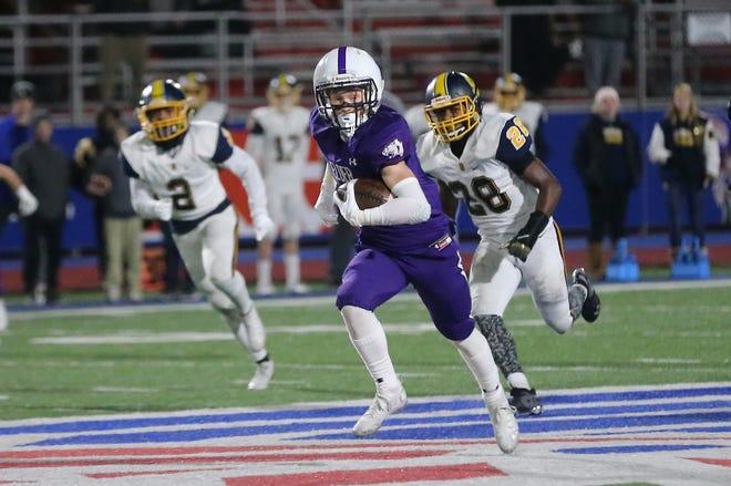 Elder wide receiver Evan Vollmer runs the ball during their 31-24 win over Springfield, Friday, Nov. 29, 2019.