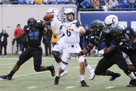 Nov 29, 2019; Memphis, TN, USA; Cincinnati Bearcats quarterback Ben Bryant (6) passes in the first quarter against the Memphis Tigers at Liberty Bowl Memorial Stadium. Mandatory Credit: Nelson Chenault-USA TODAY Sports