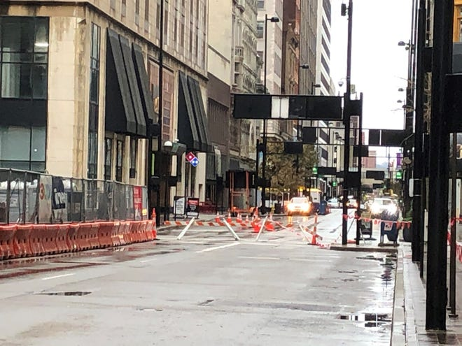 Fourth Street remained closed Saturday and officials say it won't reopen until Dec. 3