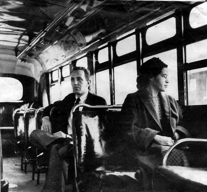 This is an undated file photo of Rosa Parks riding on the Montgomery Area Transit System bus. Parks refused to give up her seat on a Montgomery bus on Dec. 1, 1955, and ignited the boycott that led to a federal court ruling against segregation in public transportation.