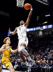Nov. 30, 2019: Xavier Musketeers guard Paul Scruggs (1) shoots during the second half against the Lipscomb Bisons forward Jacob Hobbs (22) at the Cintas Center. Xavier won 87-62.