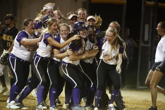 Indianola softball players celebrate a win in 2019 against Southeast Polk in a Class 5A regional final.