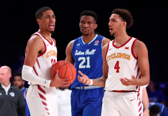Nov 29, 2019; Nassau, BHS; Iowa State Cyclones guard Tyrese Haliburton (22) and forward George Conditt IV (4) react in front of Seton Hall Pirates center Ike Obiagu (21) during the first half at Imperial Arena. Mandatory Credit: Kevin Jairaj-USA TODAY Sports