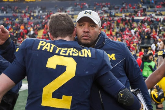 Michigan quarterback Shea Patterson is comforted by offensive coordinator Josh Gattis after the 56-27 loss to Ohio State at Michigan Stadium, Saturday, Nov. 30, 2019.