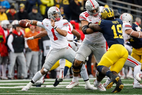 Ohio State quarterback Justin Fields passes against Michigan during the second half at Michigan Stadium, Saturday, Nov. 30, 2019.
