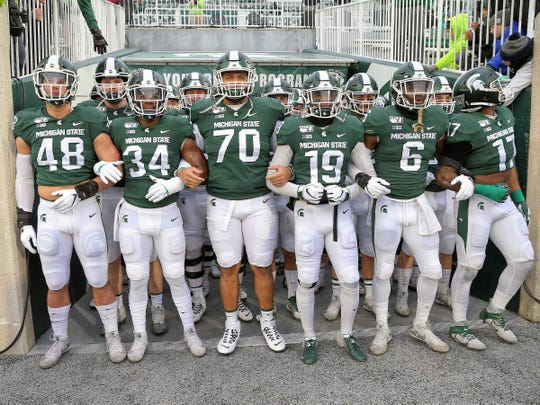 Michigan State defense prepares to take the field vs. Maryland on Saturday, Nov. 30, 2019.