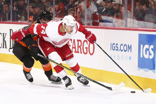 Detroit Red Wings' Madison Bowey battles for the puck ahead of the Philadelphia Flyers' Joel Farabee in the third period in Philadelphia on Friday, Nov. 29, 2019. The Flyers won, 6-1.