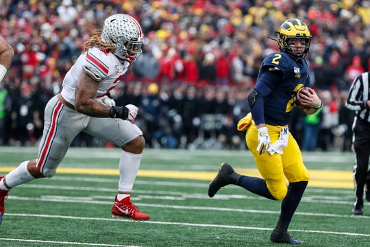 Ohio State defensive end Chase Young chases Michigan quarterback Shea Patterson during the second half at Michigan Stadium, Saturday, Nov. 30, 2019.