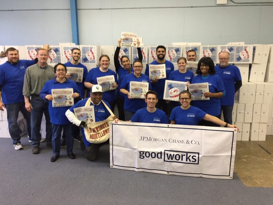 JP Morgan Chase employees helping the Old Newsboys Goodfellow Fund of Detroit, which is raising funds for 30,000 holiday gift boxes that will be distributed to children in need across metro Detroit this season.