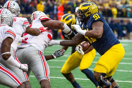 Michigan offensive lineman Cesar Ruiz (51) blocks a Ohio State defender at Michigan Stadium, Saturday, Nov. 30, 2019.