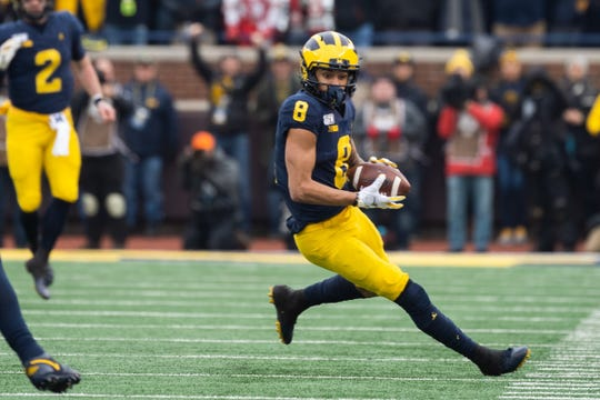 Michigan wide receiver Ronnie Bell completes a pass during the game against Ohio State at Michigan Stadium on Saturday, Nov. 30, 2019.