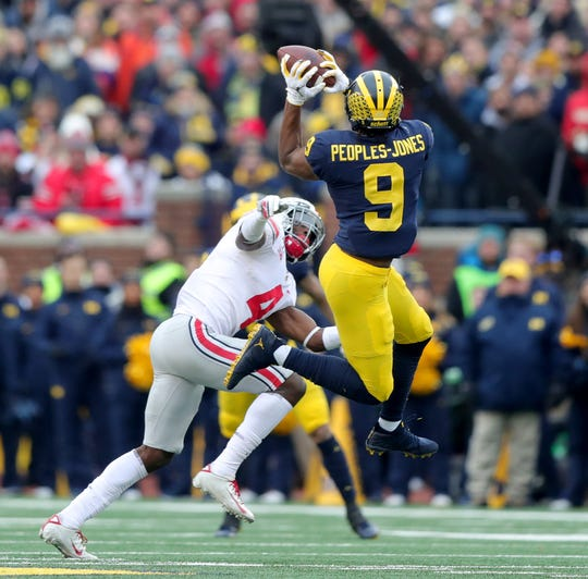 Michigan Wolverines receiver Donovan Peoples-Jones goes up for a pass against Ohio State Buckeyes safety Jordan Fuller during the second half at Michigan Stadium in Ann Arbor, Saturday, Nov. 30, 2019.