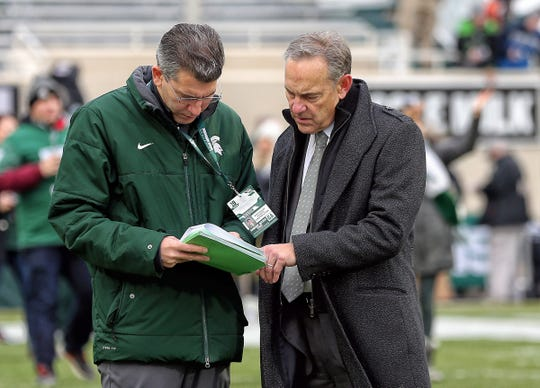 Michigan State coach Mark Dantonio goes over his roster Saturday before beating Maryland to get bowl eligible. The Spartans are 6-6 and await their bowl placement.