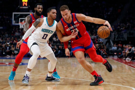 Blake Griffin rejects a pick from Andre Drummond and drives vs. Miles Bridges on Friday at LCA.