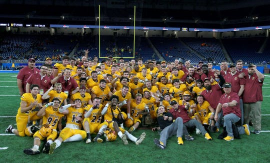 Davison pose for their group picture after they beat Brighton 35-25 in the Division 1 state championship football game 35-25 over Brighton to win their first ever state football championship at Ford Field on Saturday, November 30, 2019.