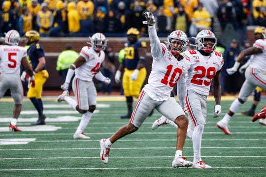 Ohio State cornerback Amir Riep (10) celebrates his interception against Michigan during the second half at Michigan Stadium, Saturday, Nov. 30, 2019.