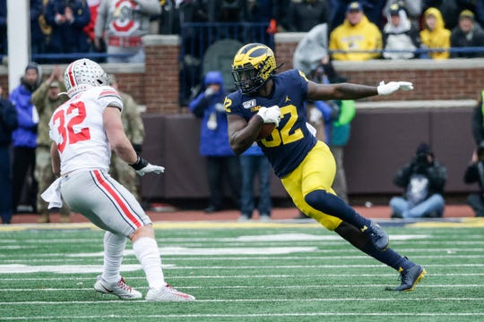 Michigan tight end Nick Eubanks runs against Ohio State linebacker Tuf Borland  during the first half at the Michigan Stadium in Ann Arbor, Saturday, Nov. 30, 2019.