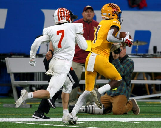 Brighton #7 Carson Billig can't catch up with the speed of Davison #1 Latrell Fordham as he runs for a touchdown during the first half of the Division 1 state championship football game between Brighton and Davison at Ford Field on Saturday, November 30, 2019.