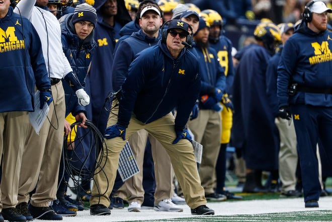 Michigan coach Jim Harbaugh watches a play against Ohio State during the second half at Michigan Stadium, Saturday, Nov. 30, 2019.