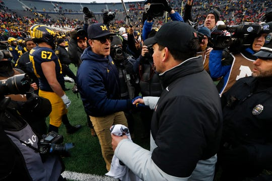 Ohio State coach Ryan Day shakes hands with Michigan coach Jim Harbaugh after the game at Michigan Stadium, Nov. 30, 2019. Ohio State won, 56-27.