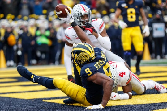 Donovan Peoples-Jones signals that he scored a touchdown against Ohio State but it was called incomplete during the first half.