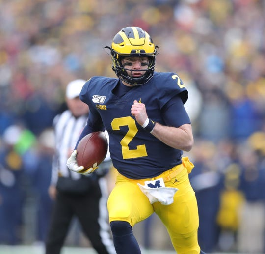 Michigan Wolverines quarterback Shea Patterson runs the ball against the Ohio State Buckeyes during the first half Saturday, Nov. 30, 2019 at Michigan Stadium.