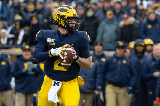 Michigan quarterback Shea Patterson looks for an opening at Michigan Stadium, Saturday, Nov. 30, 2019. Ohio State defeated Michigan, 56-27.