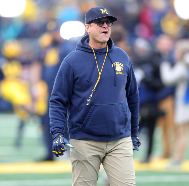 Michigan coach Jim Harbaugh on the field before action against Ohio State on Saturday, Nov. 30, 2019, at Michigan Stadium.