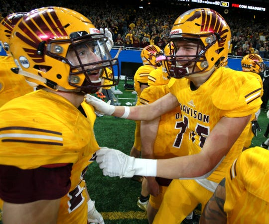 Davison players start to celebrate on the sideline as the seconds tick down on the clock as the school gets their first ever state football championship beating Brighton 35-25 in the Division 1 state championship football game at Ford Field on Saturday, November 30, 2019.
