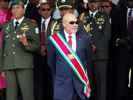 "FILE - In this Aug. 12, 2015 file photo, Suriname President Desire ""Desi"" Delano Bouterse observes a military parade, after being sworn in for his second term, in Paramaribo, Suriname."