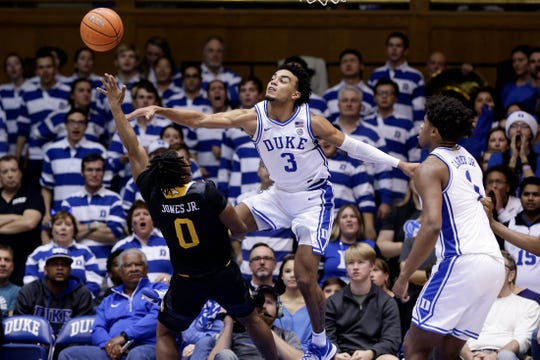 Duke guard Tre Jones blocks Winthrop guard Russell Jones in the second half.