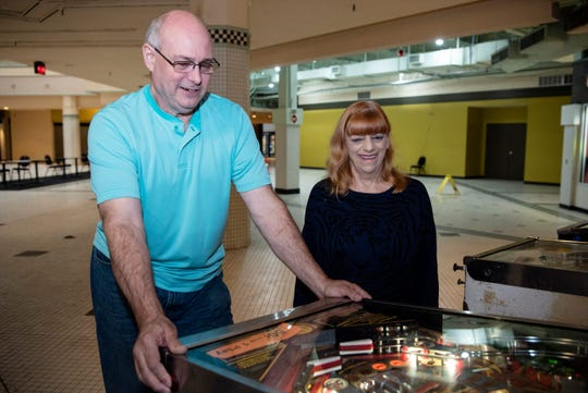 Terry Groves and wife Jane play pinball at Playable Pinball Museum inside McCamly Place.