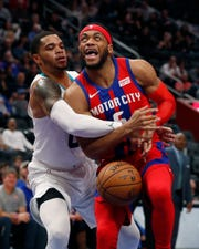 Charlotte Hornets forward Miles Bridges, a former Michigan State star, fouls Pistons guard Bruce Brown during the first half.