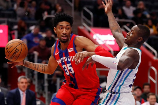 Pistons forward Christian Wood looks to pass as Hornets guard Terry Rozier defends during the first half.