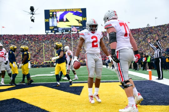 Ohio State's J.K Dobbins (2) celebrates after scoring on a 5-yard run during the first quarter against Michigan.