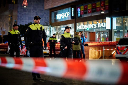 Dutch police secure a shopping street after a stabbing incident in the center of The Hague, Netherlands, Friday, Nov. 29, 2019.