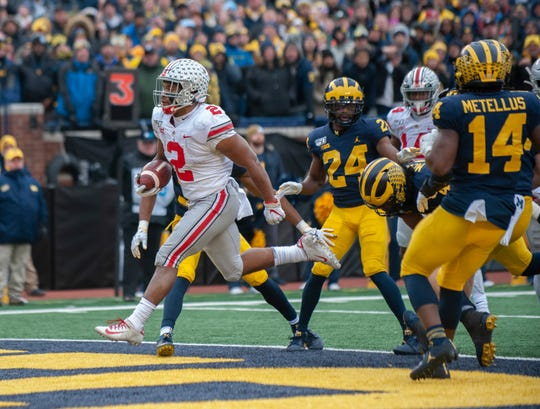 Ohio State running back J.K. Dobbins scores the first of two second-quarter rushing touchdowns.
