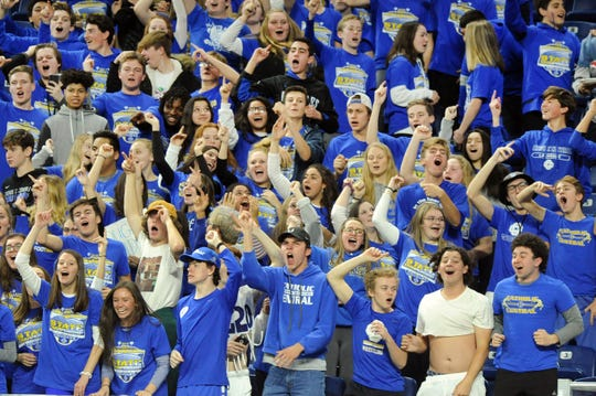 Grand Rapids Catholic Central fans celebrate after quarterback Joe Silveri ran for a touchdown against Detroit Country Day in the first quarter.