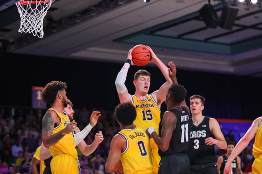 Michigan center Jon Teske grabs a  rebound in the Battle 4 Atlantis championship game.
