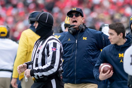 Michigan head coach Jim Harbaugh yells at the officials in the first quarter.